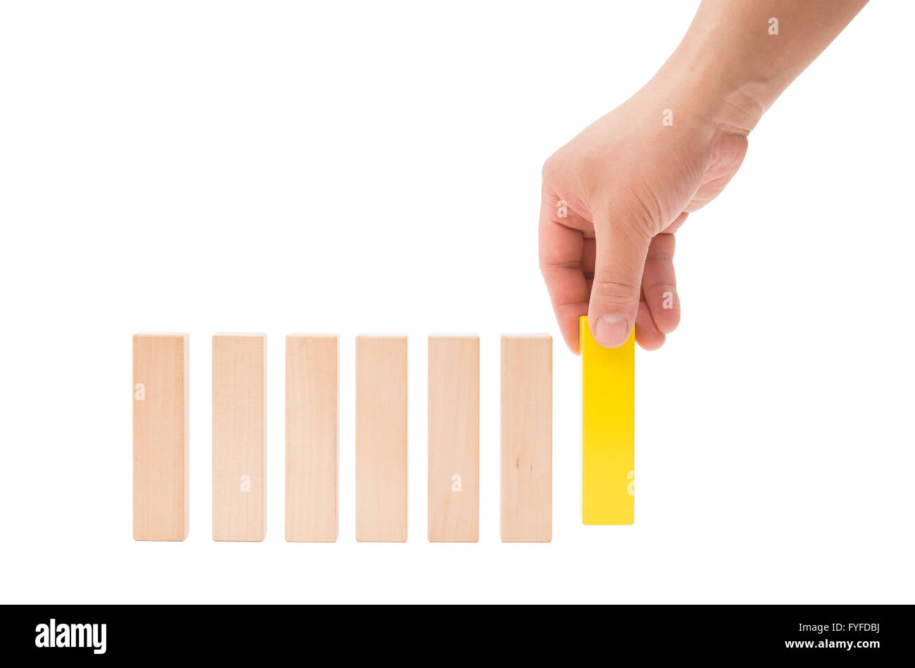 making up a line of wooden toy blocks on white background with clipping path - Stock Image