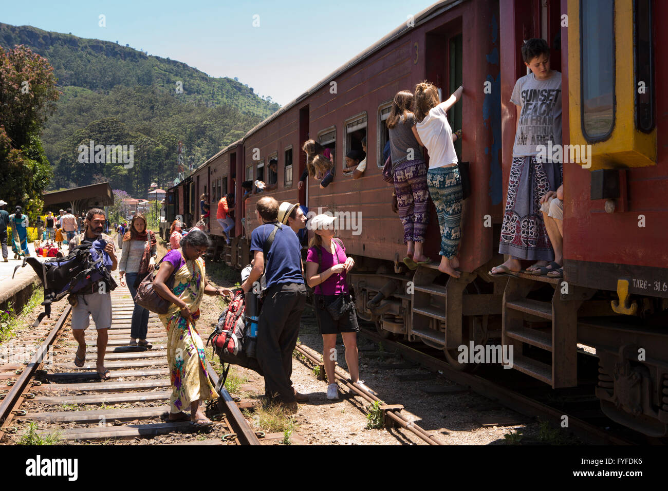 Sri Lanka, Ella Railway Station, backpackers boarding 3rd class carriage - Stock Image