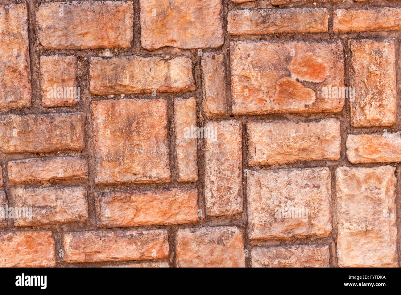 Closeup Of Red Brick Patterns And Textures On Concrete Wall Stock