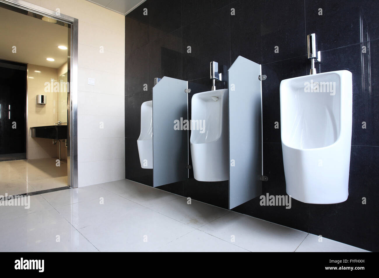 Public toilets, men's urinal - Stock Image