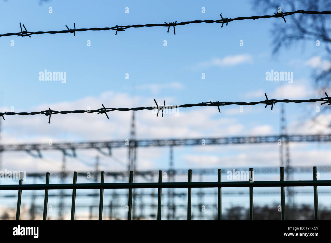 Electrical Net Stock Photos Images Alamy Electric Barbed Wire Free Photo Public Domain Pictures Electricity Sub Station Behind Against Blue Sky Image