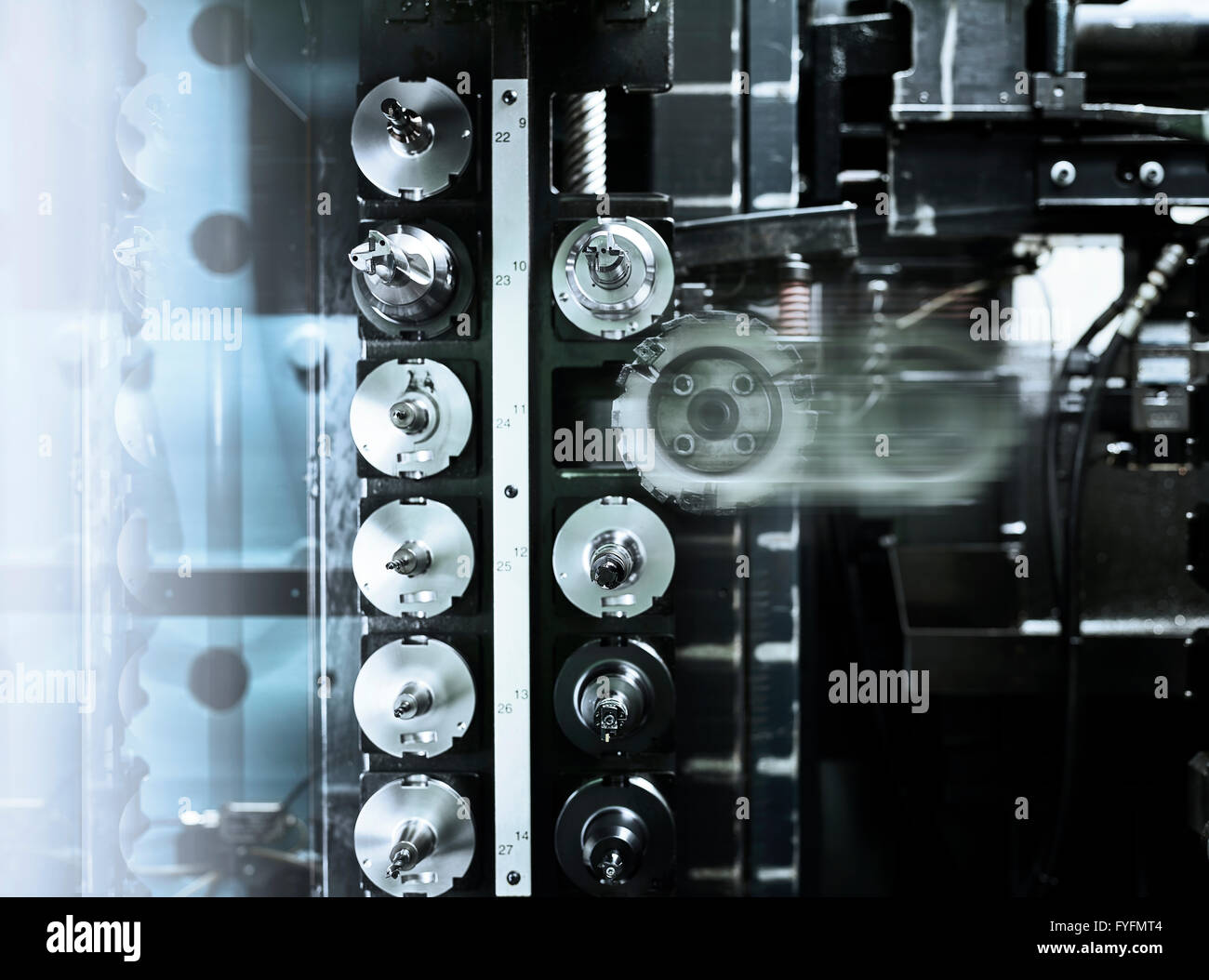 Different tools of a CNC milling machine, tool bit being changed - Stock Image