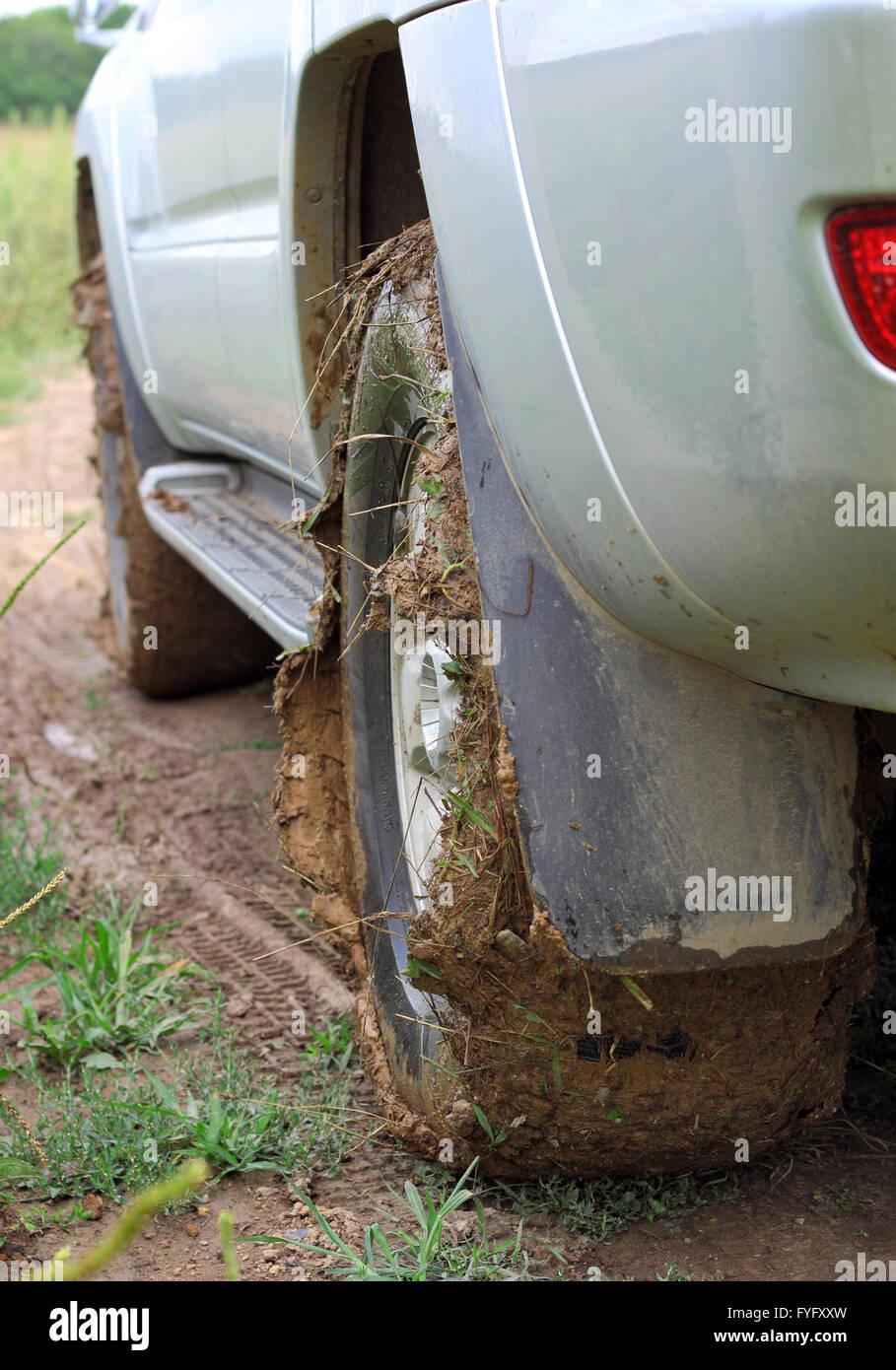 Extreme offroad behind an unrecognizable car in mud - Stock Image