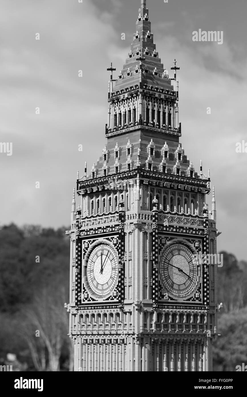 A black and white photo of a mini Big Ben clock. - Stock Image