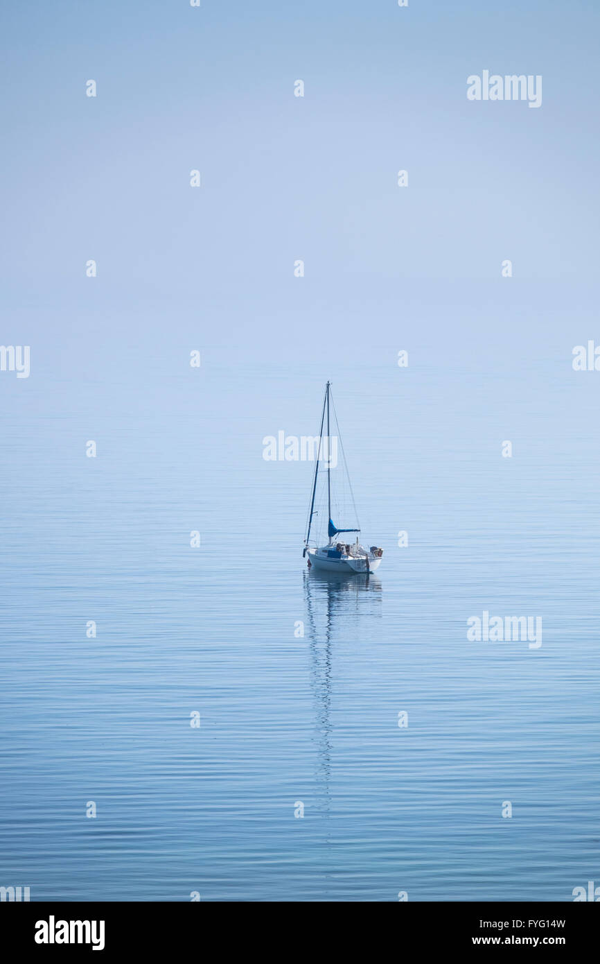 Yacht anchored off the Dorset coast - Stock Image