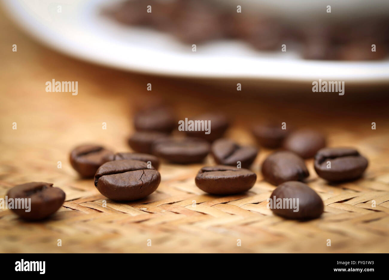 Roasted coffee bean on textured surface - Stock Image