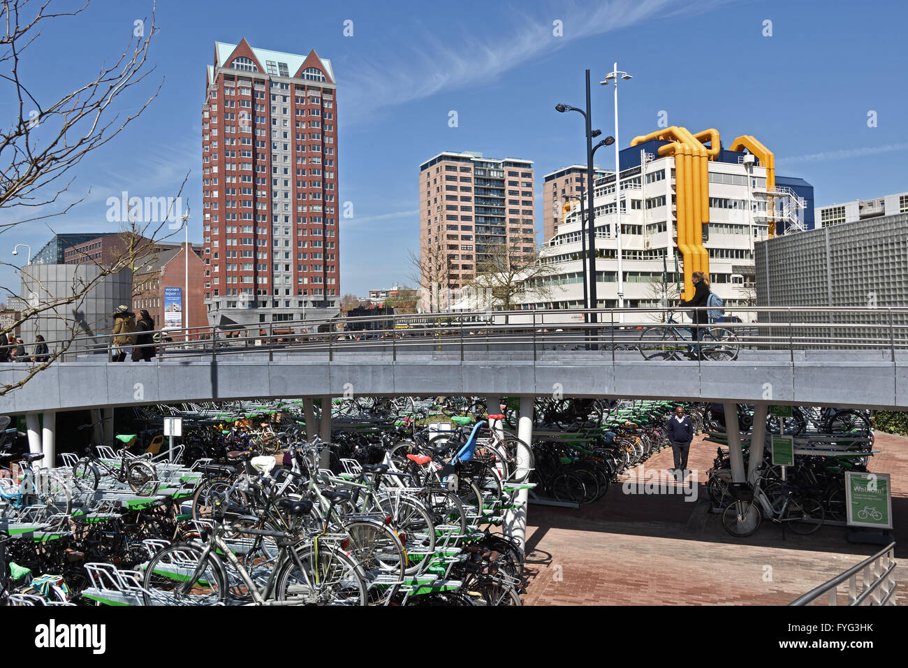 Public bike bicycle storage parking park  city center of Rotterdam Blaak square  Netherlands Central Library  Residence - Stock Image