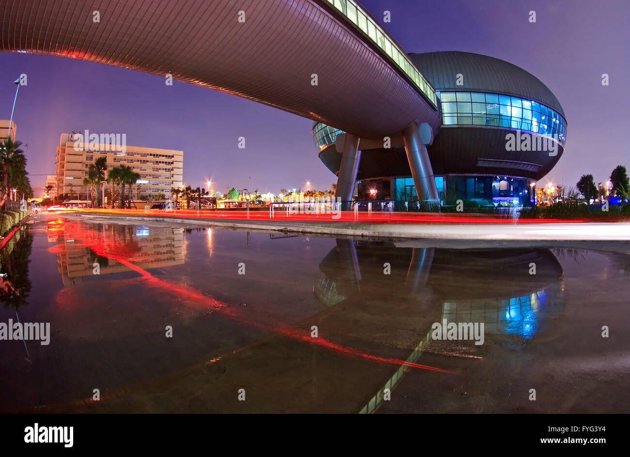 Light Trail and Government Complex Building dome shines at Dusk in Bangkok Thailand. Stock Photo