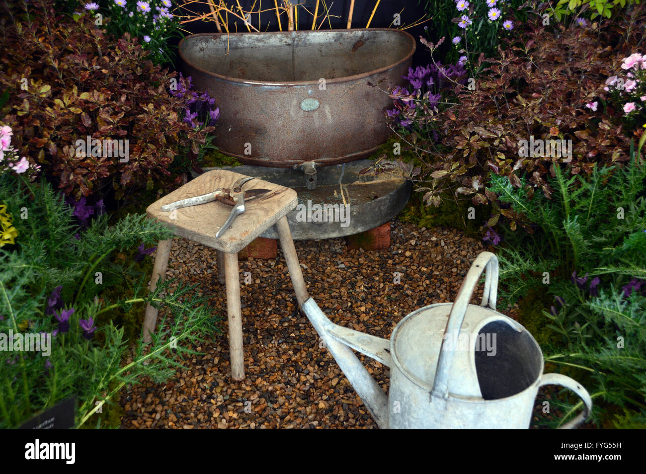 Tin Bath & Watering Can with Wooden Stool & Secateurs in Garden Display at the Harrogate Spring Flower Show. - Stock Image
