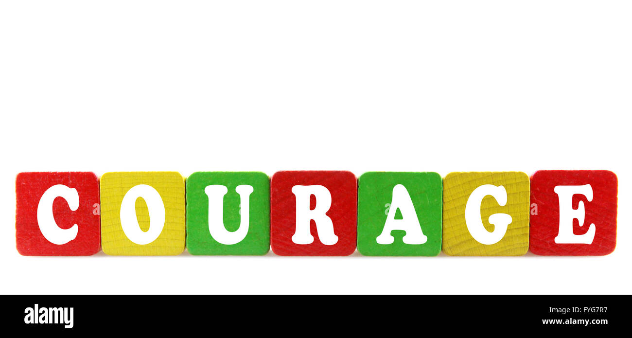 courage - isolated text in wooden building blocks - Stock Image