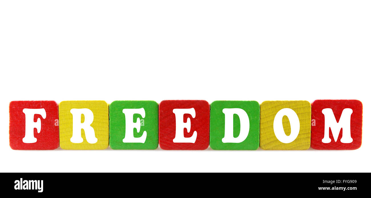 freedom - isolated text in wooden building blocks - Stock Image