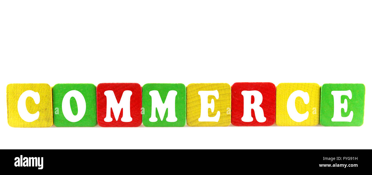 commerce - isolated text in wooden building blocks - Stock Image