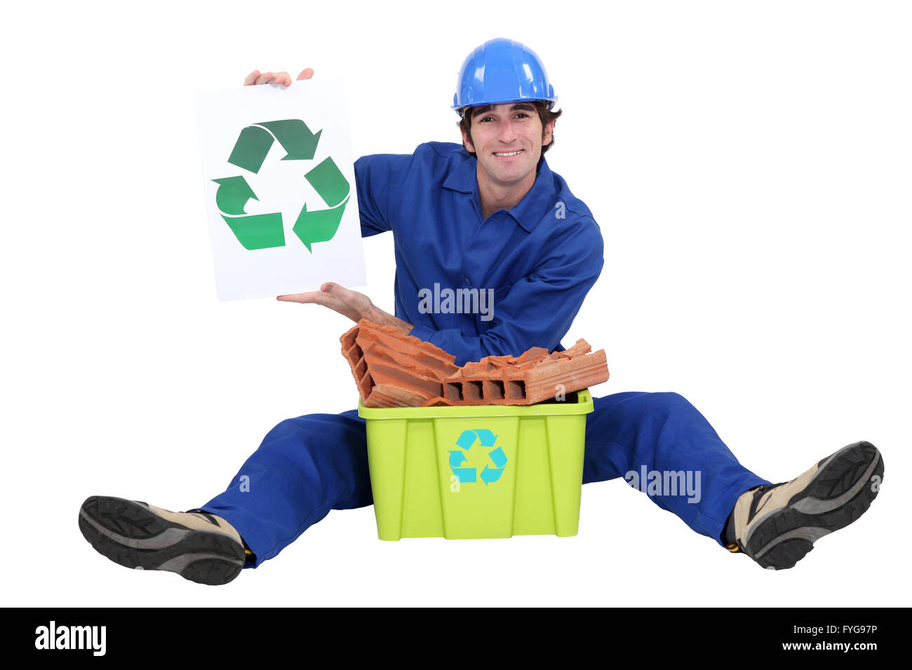 Builder sat with box of rubble to be recycled Stock Photo