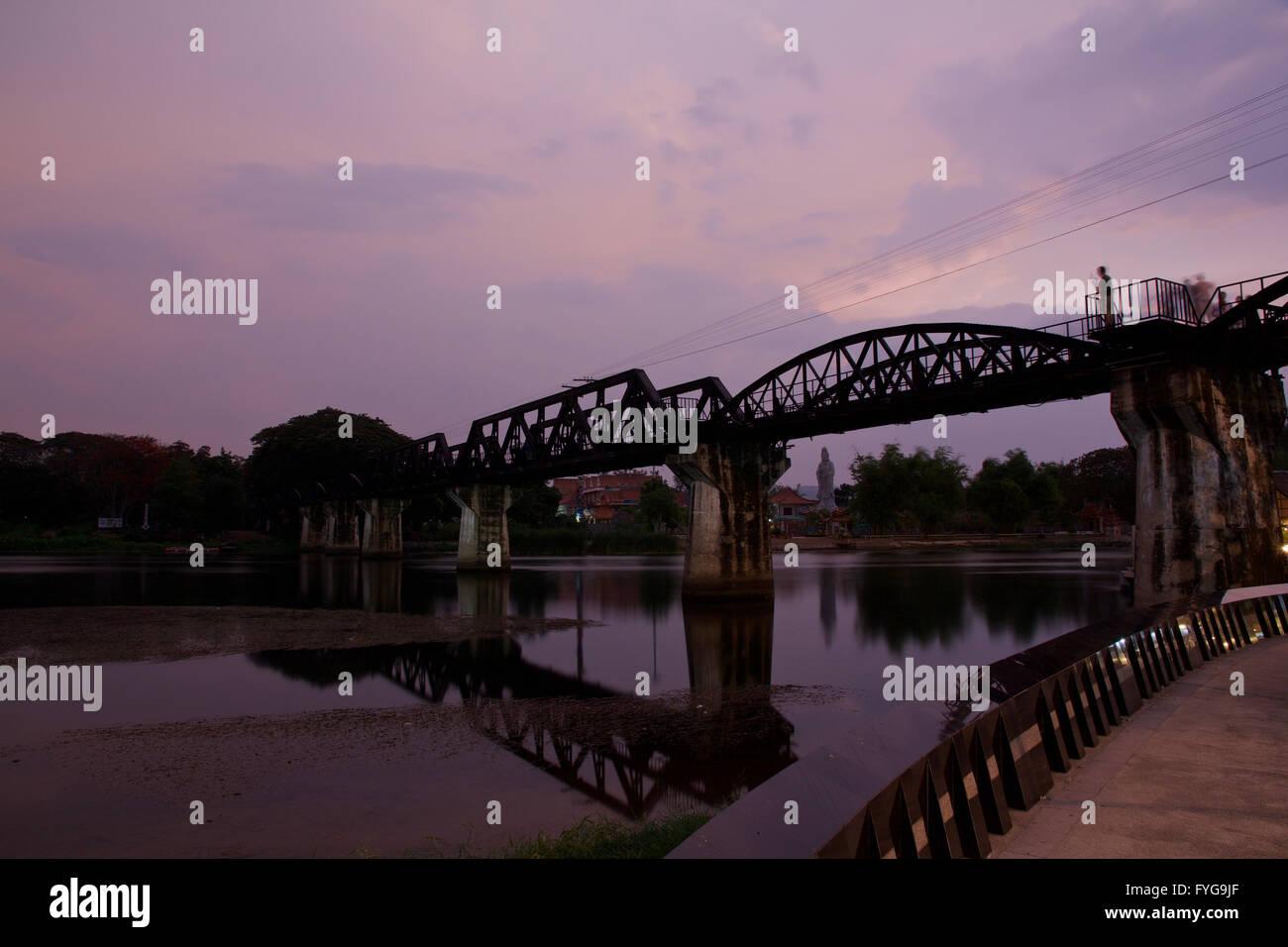 Bridge over The River Kwai after sunset - Kanchanaburi, Thailand - Stock Image
