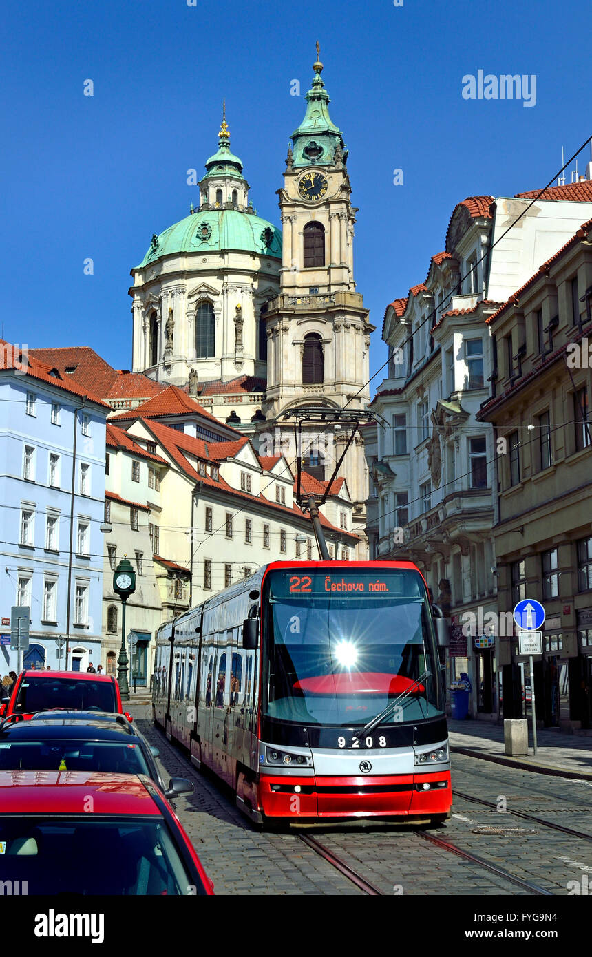 Prague, Czech Republic. Modern tram / streetcar (Škoda 15T / ForCity Alfa)  in Ujezd (street) St Nicholas Church - Stock Image