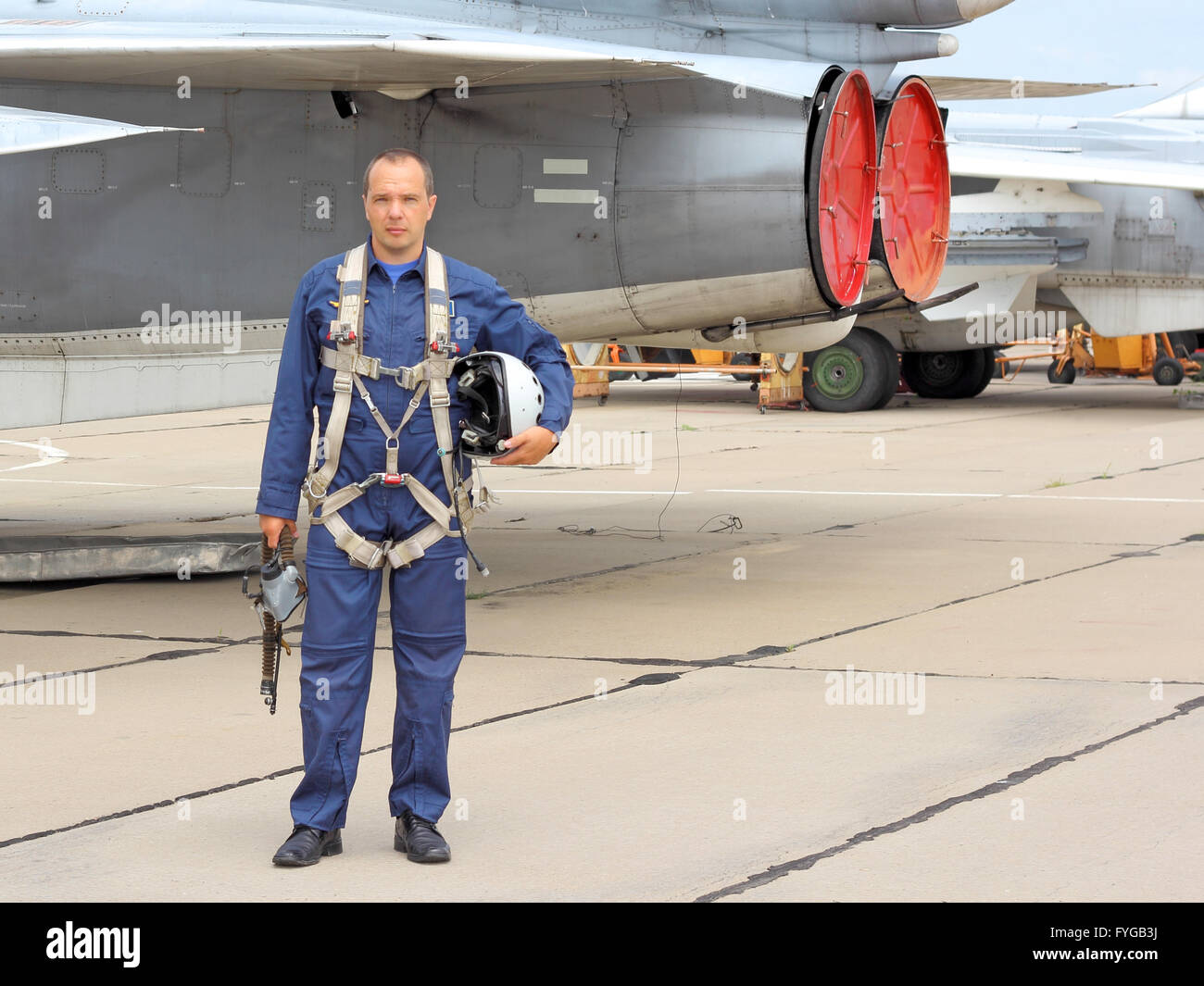 military pilot in a helmet near the aircraft - Stock Image
