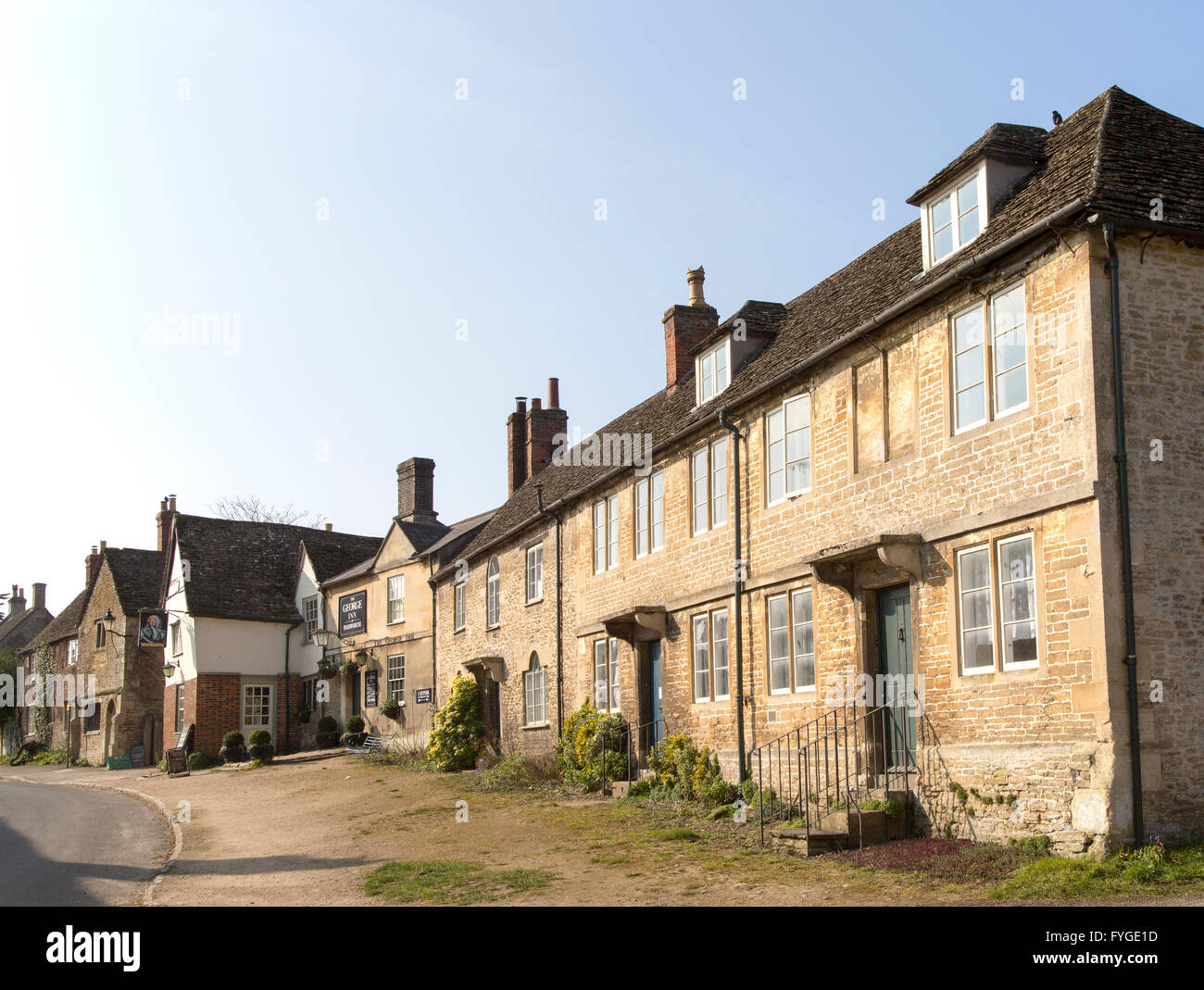 Historic houses and The George Inn at the village of Lacock, Wiltshire, England, UK - Stock Image
