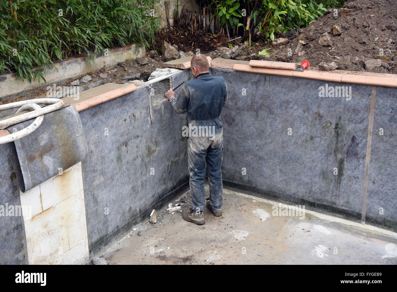 Swmming pool repair new skimmer  and liner - Stock Image