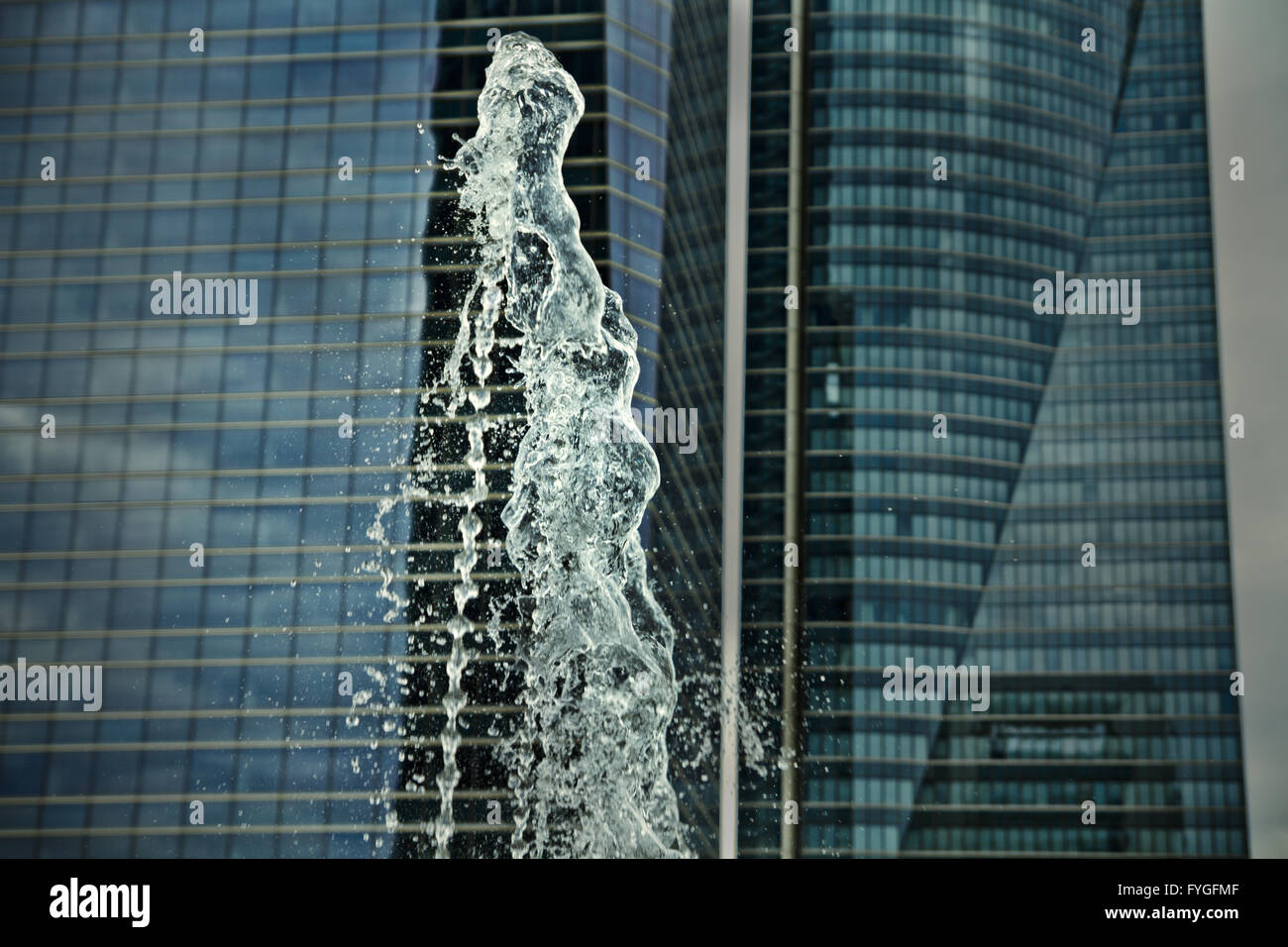 water jets, office building source, towers at background Stock Photo