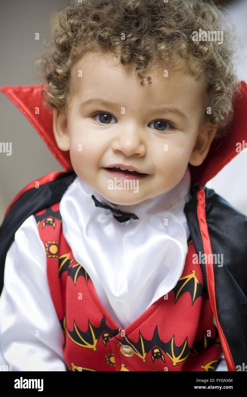 beautiful blond boy dressed with vampire curls - Stock Image