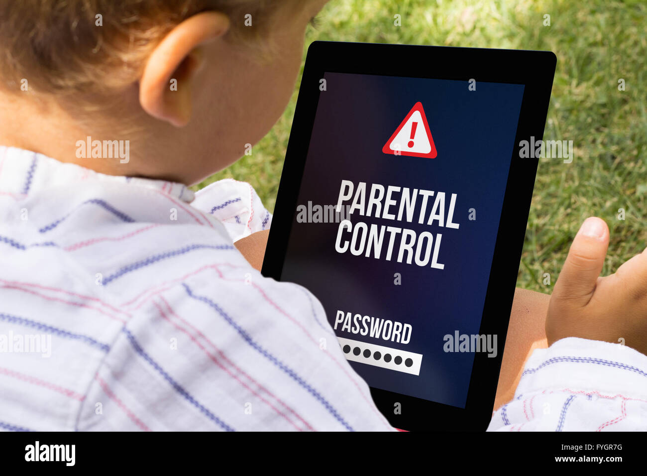 child with parental control at a tablet - Stock Image