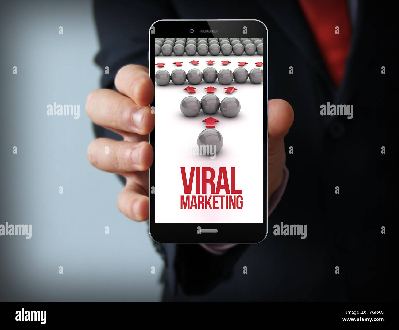 businessman holding viral marketing 3d generated smartphone - Stock Image