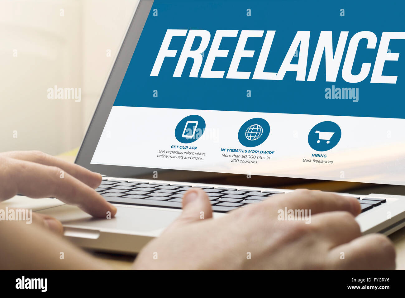 online work concept: man using a laptop with freelance on the screen. Screen graphics are made up. - Stock Image