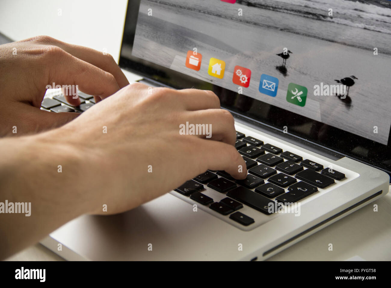 work concept: man using a laptop with colorful interface - Stock Image