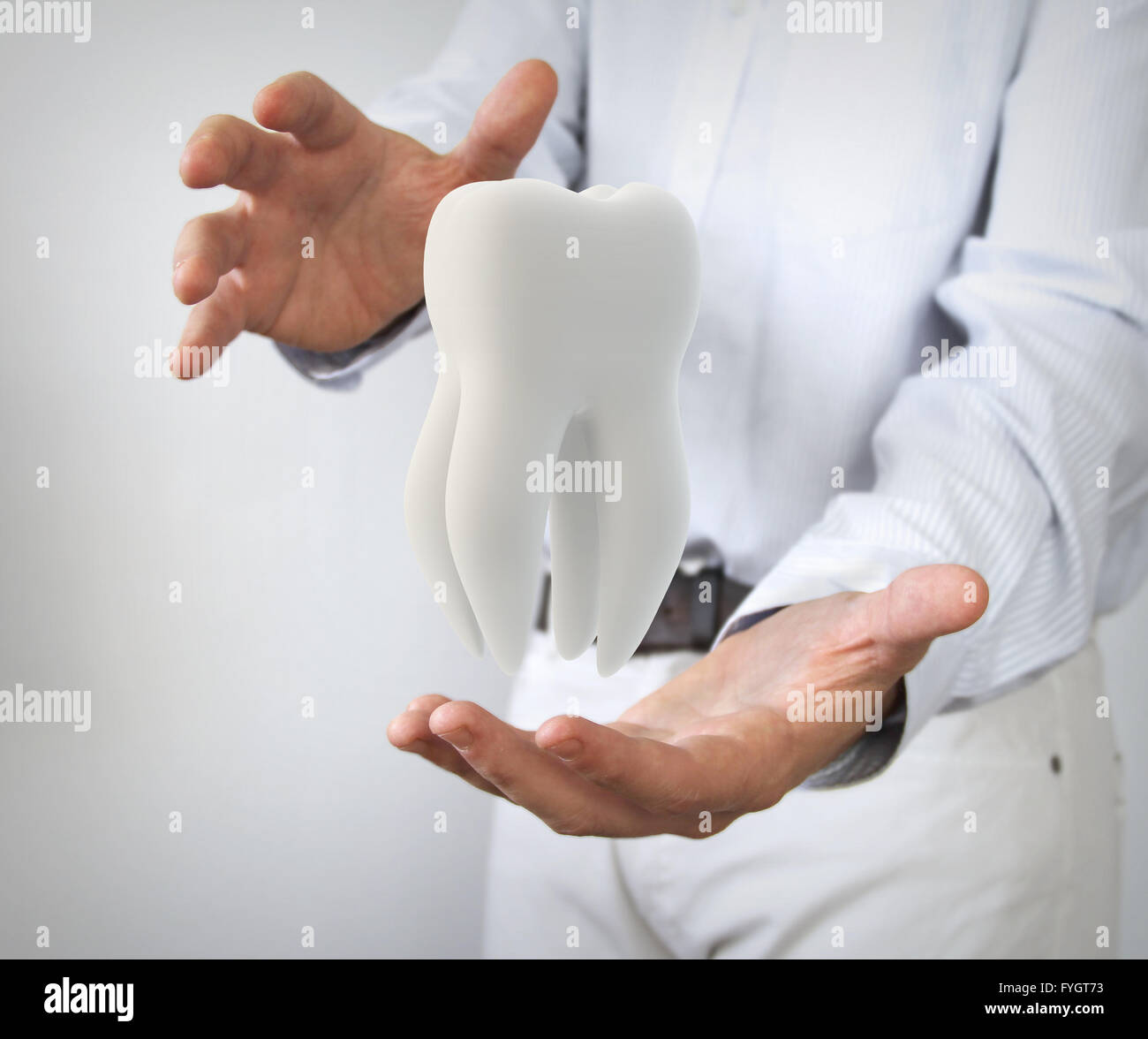 dental care concept: molar tooth in man hands - Stock Image