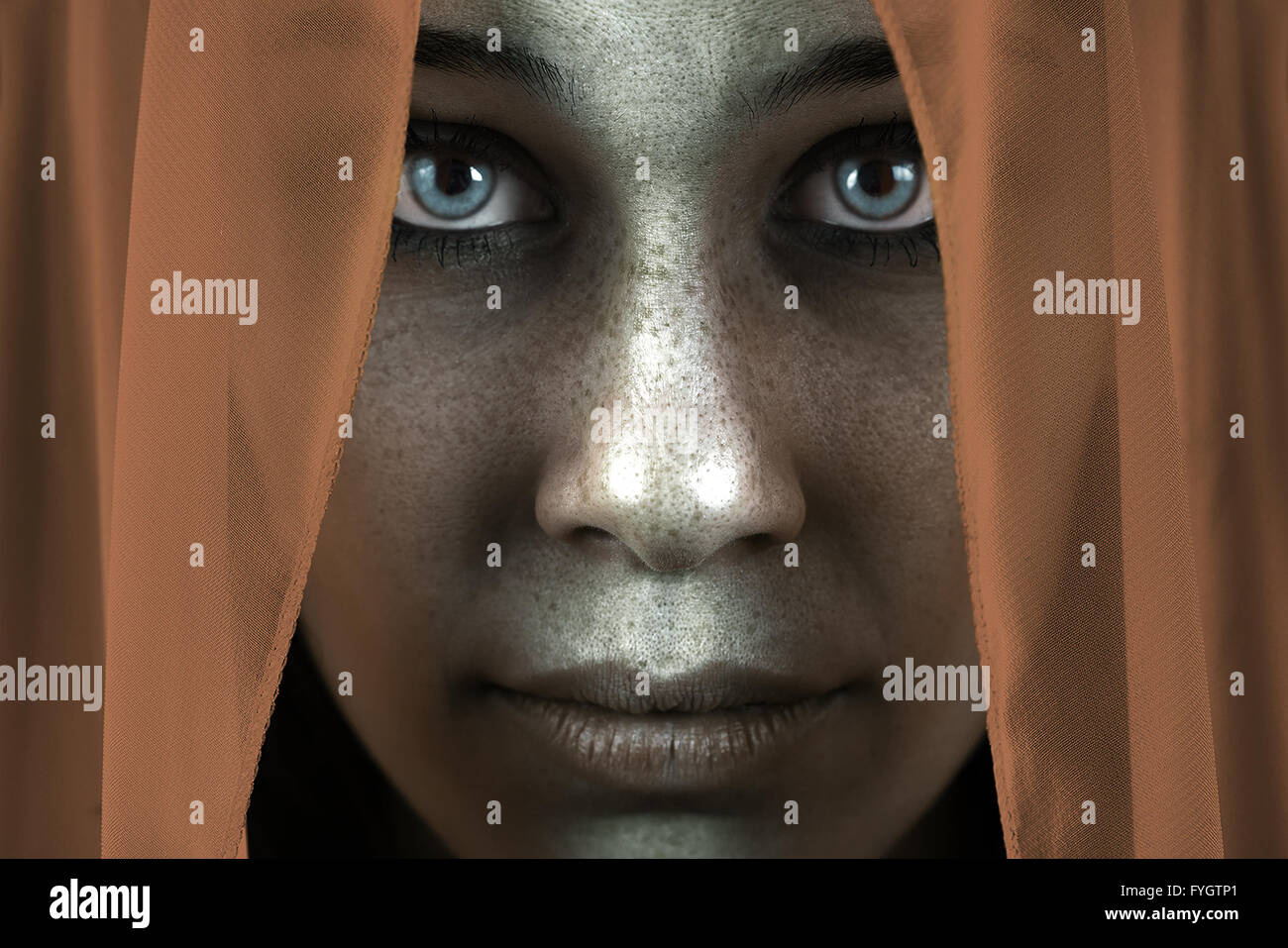 Face of shy freckled woman with veil and beautiful eyes - Stock Image