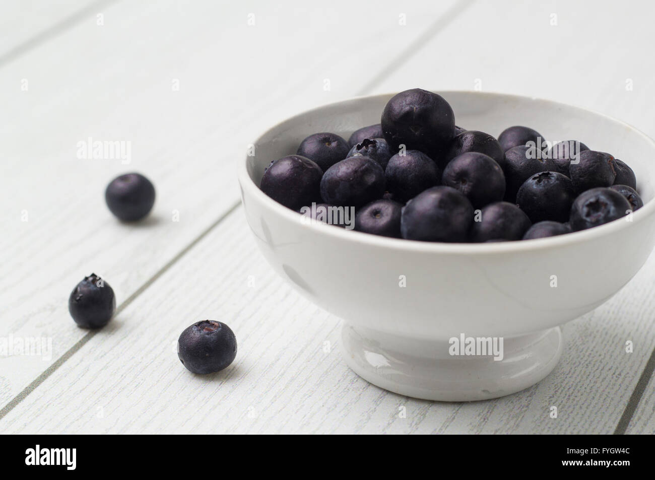 Blueberry antioxidant organic superfood in a bowl concept for healthy eating and nutrition - Stock Image