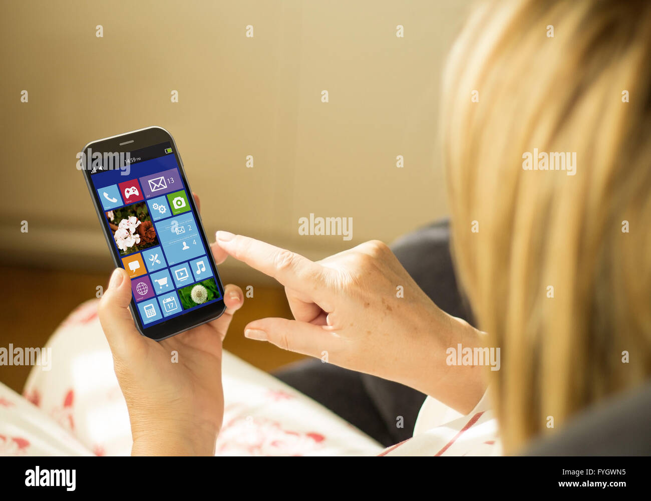 mobility and wireless concept: young woman with a 3d generated smartphone. All screen graphics made up. - Stock Image