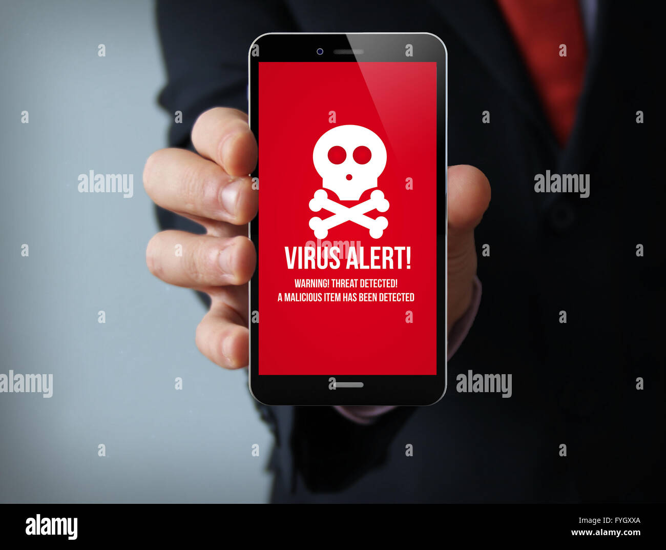 new technologies security concept: businessman hand holding a 3d generated touch phone with virus alert on the screen. - Stock Image