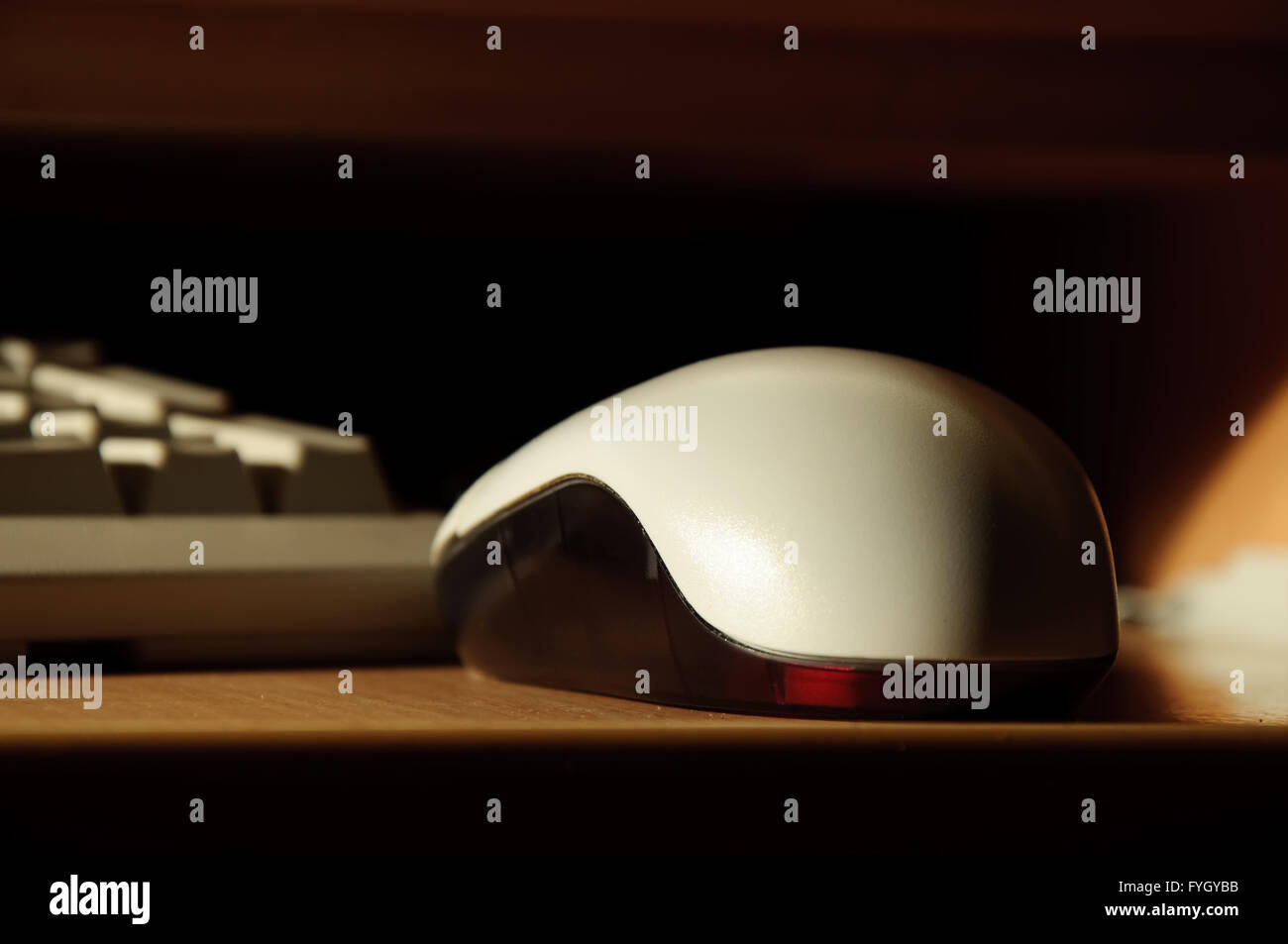 optical computer mouse in dark - Stock Image