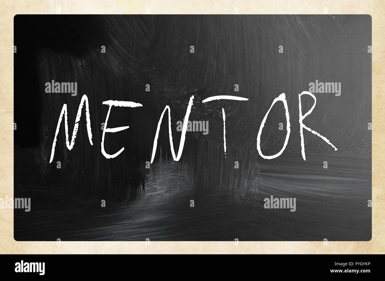 Mentor handwritten with white chalk on a blackboard - Stock Image