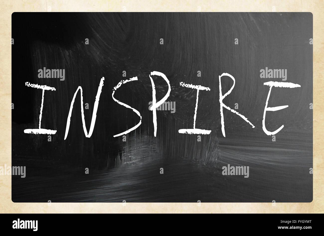 Inspire handwritten with white chalk on a blackboard - Stock Image