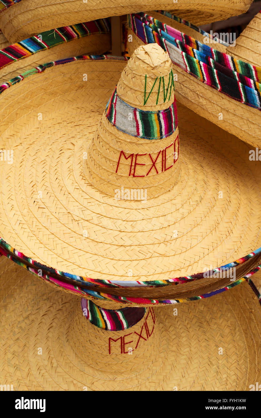 Mexican street market fair display of traditional sombrero hats with  colorful decoration and viva mexico text. 5eafb5506ce