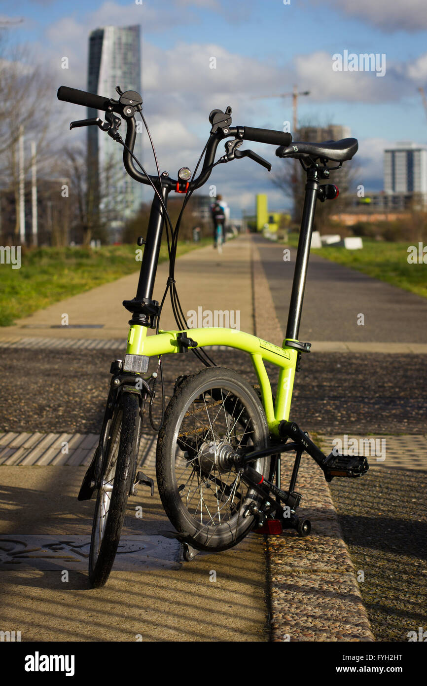 Brompton bike on cycle path in East London - Stock Image