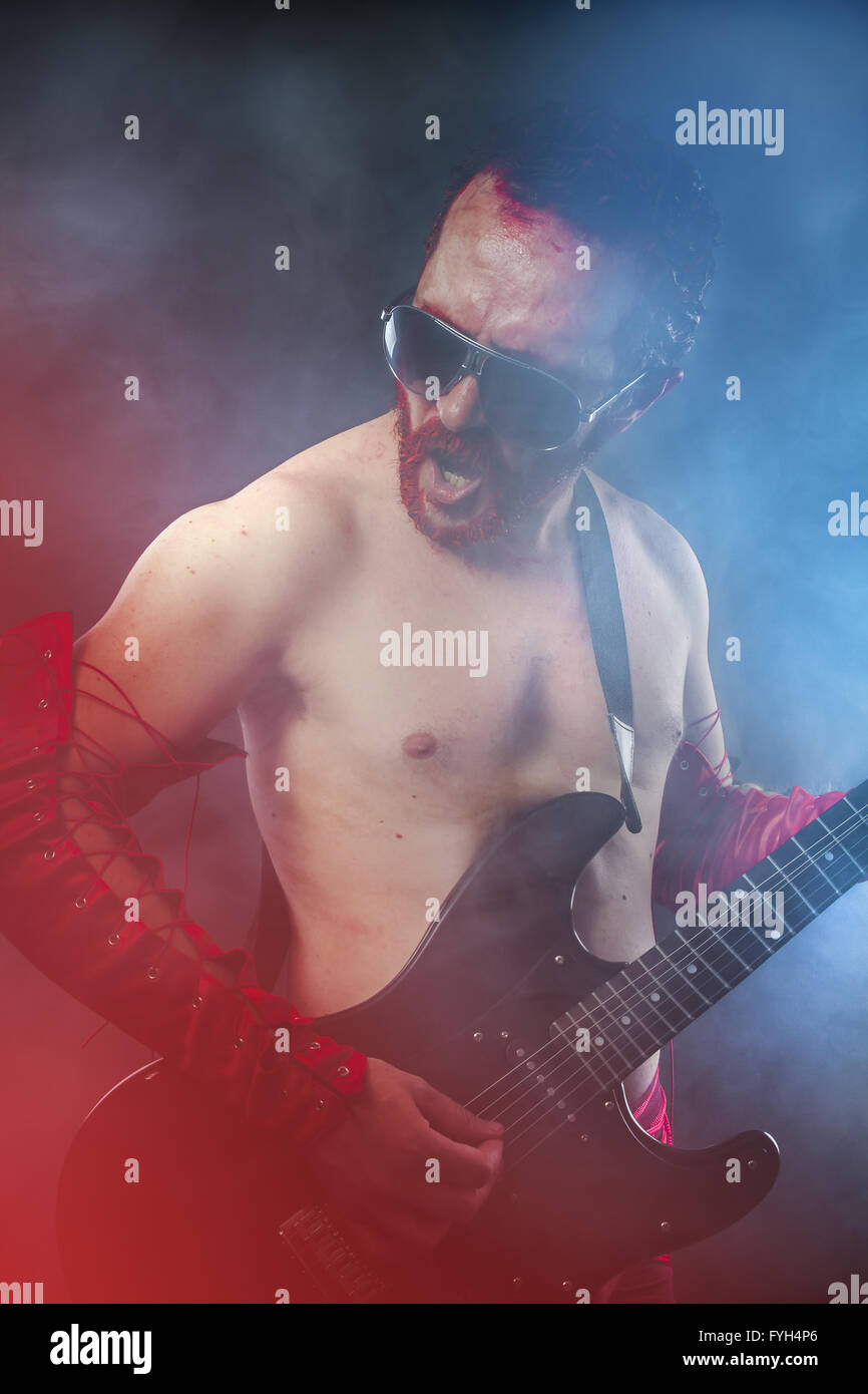 Rock star playing solo on guitar. passionate guitarist - Stock Image