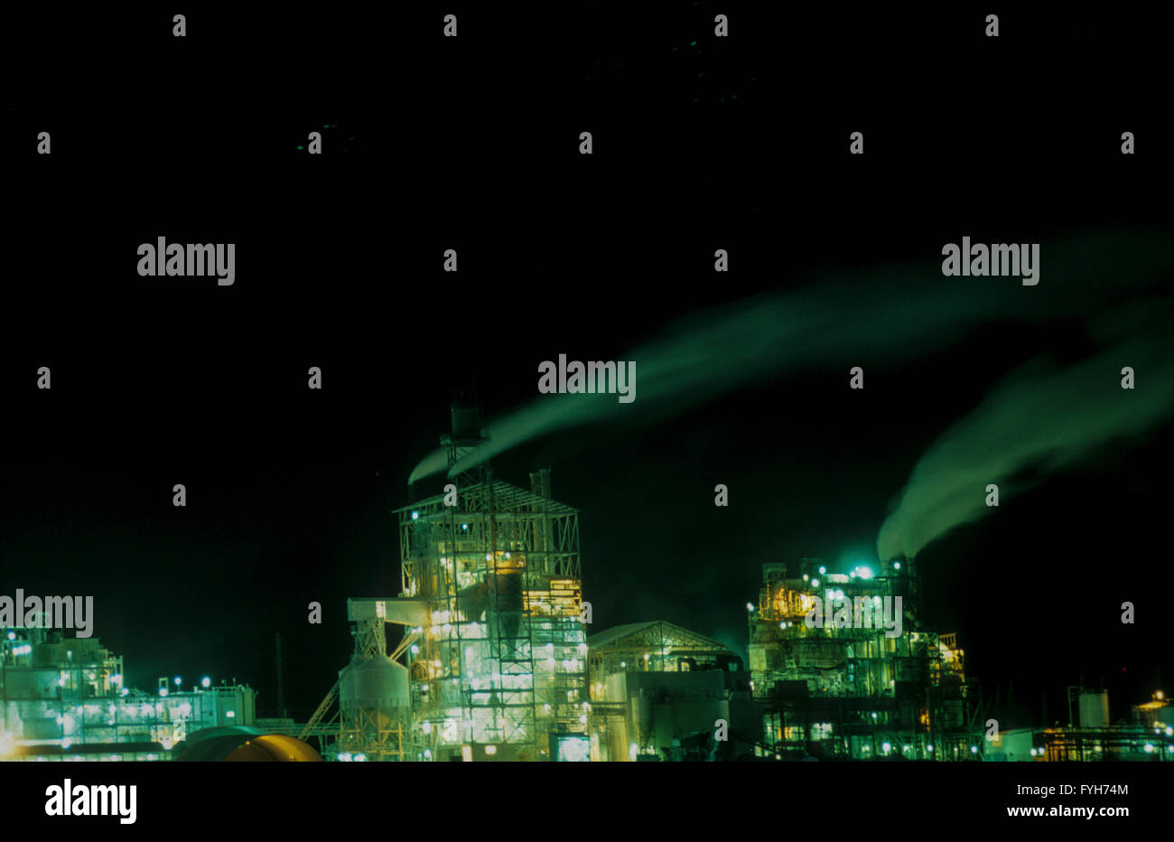 air pollution- smoking chimneys at night, at the phosphate factory, negev, israel - Stock Image