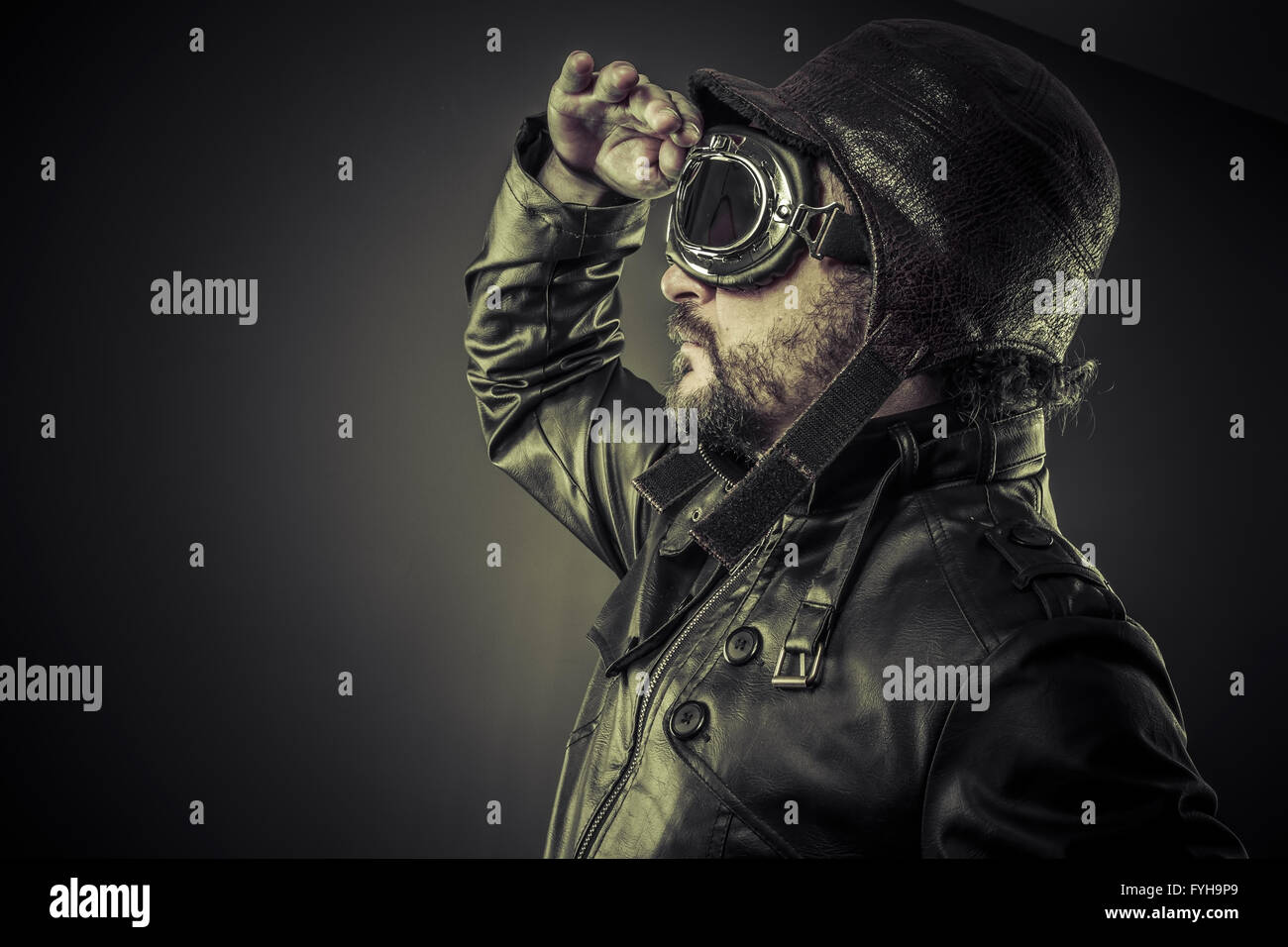 Steampunk concept, pilot vintage with big glasses, posing - Stock Image