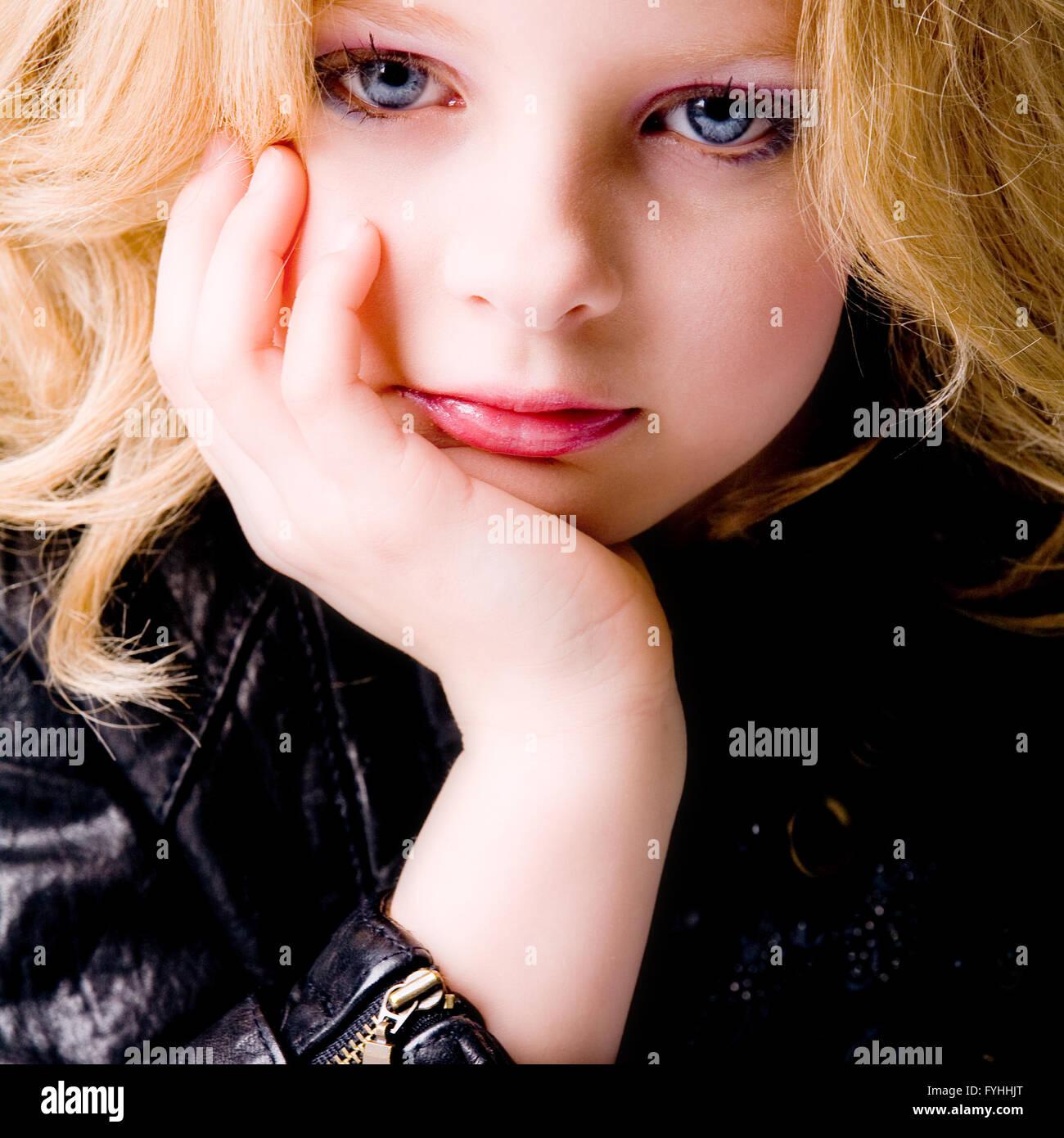 Depressive child with jacket - Stock Image