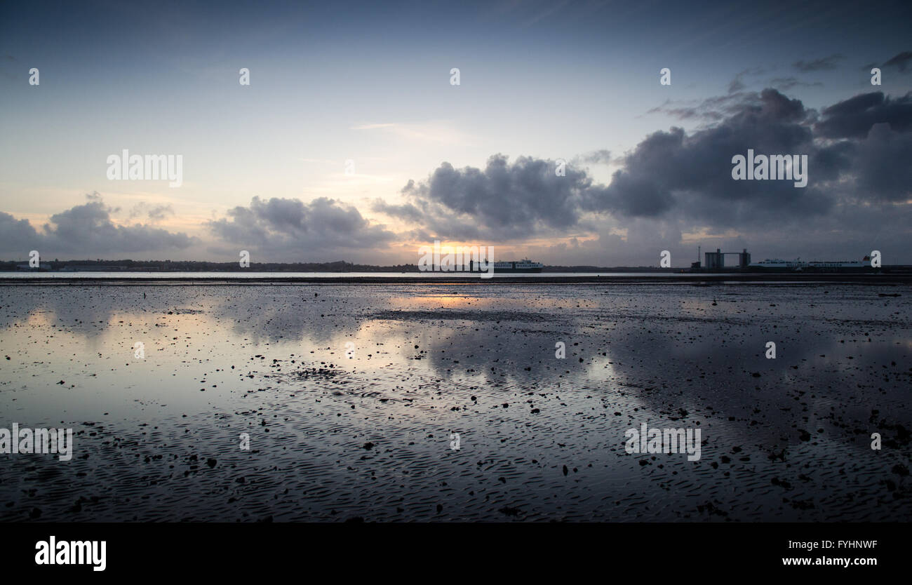 Sunset over Southampton Docks from Weston Shore. - Stock Image