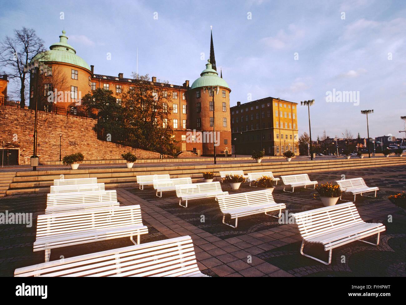 Empty park benches along harbor; Stockholm; Sweden - Stock Image