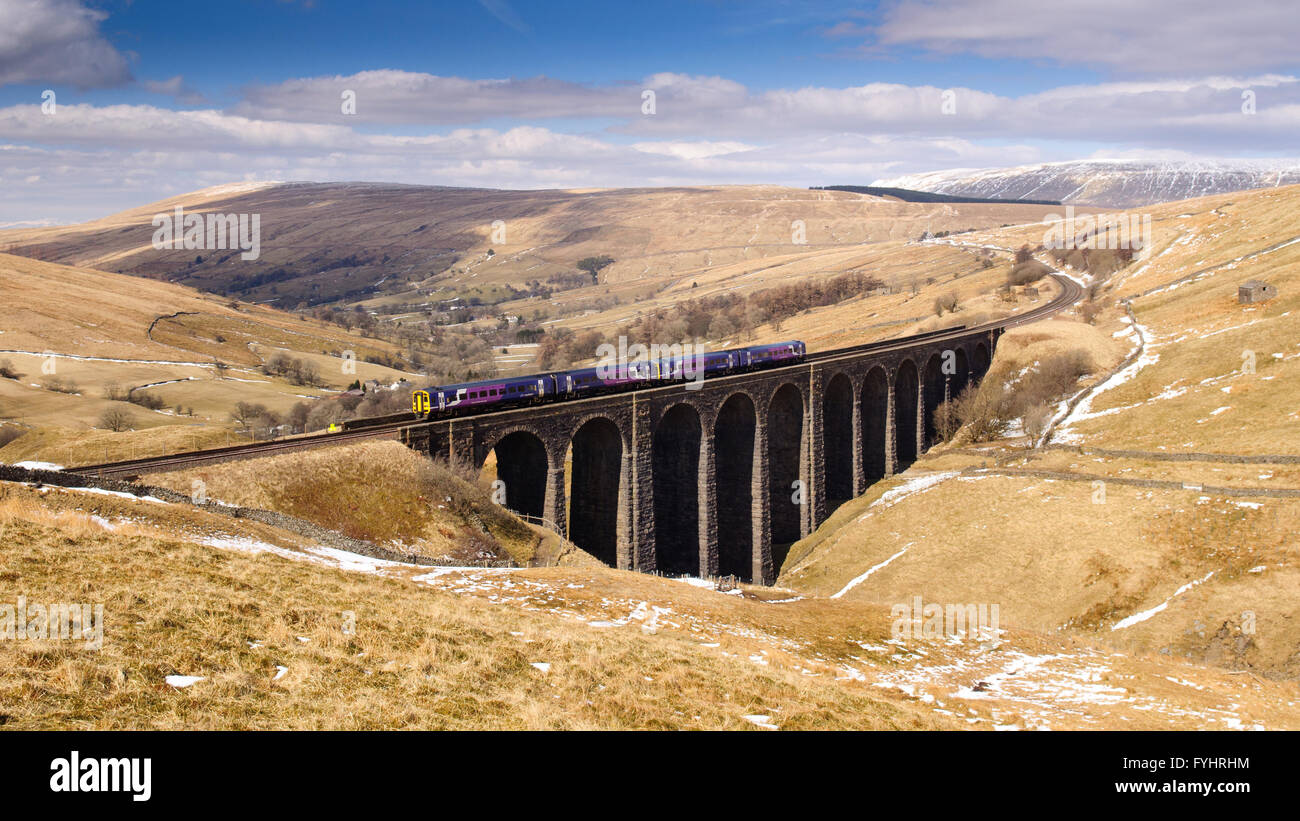 Carlisle, England - April 1, 2013: A Northern Rail Class 158 passenger train crossing the Arten Gill Viaduct on - Stock Image