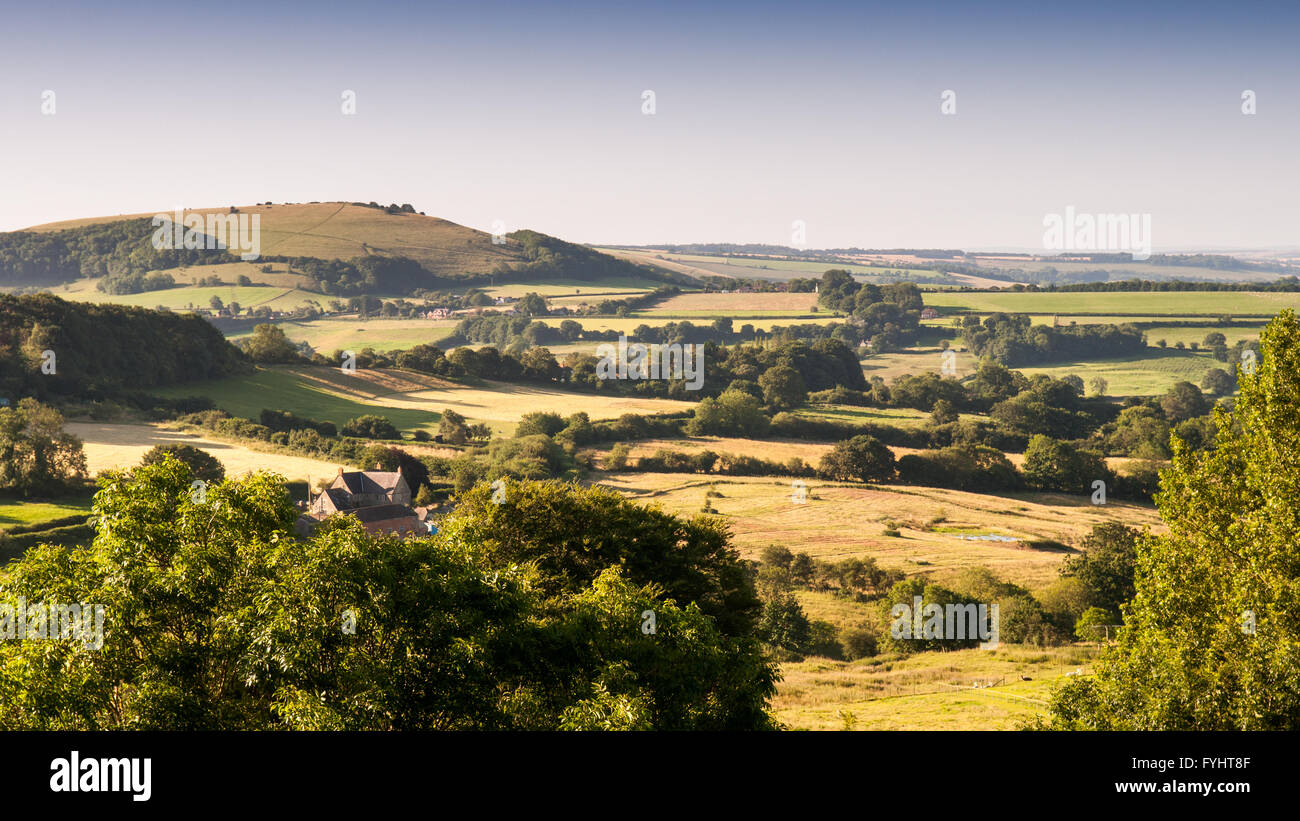 Fontmell Down and the scarp of the Cranborne Chase chalk downland at the edge of the Blackmore Vale in North Dorset. - Stock Image