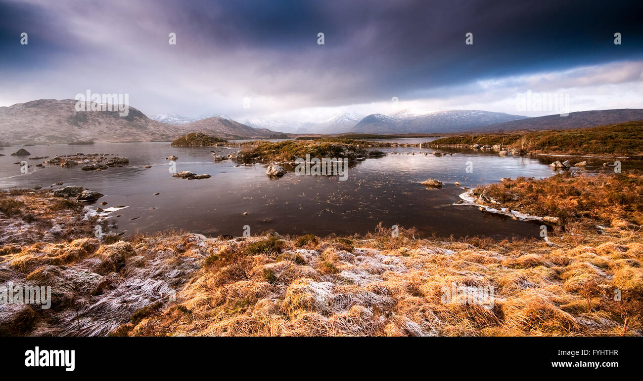 Lochan na h-Achlaise on Rannoch Moor, a vast peat bog in the Scottish Highlands, frozen and frost-covered on a winter - Stock Image