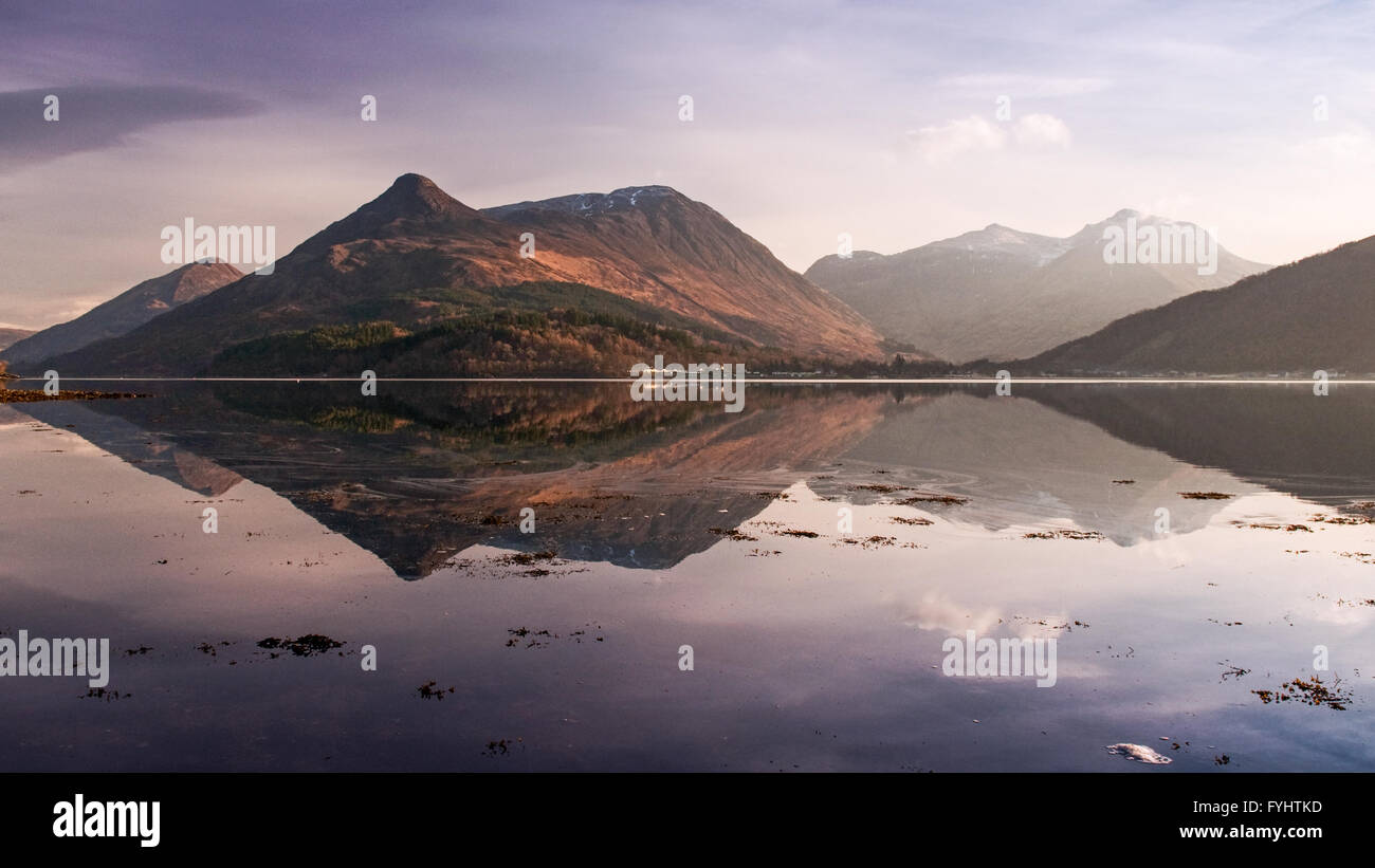 Reflections of Glen Coe mountains in Loch Linnhe in the Scottish Highlands on a cold, calm winter day. - Stock Image
