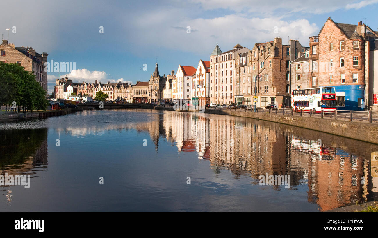 Houses and warehouses reflected in the Water of Leith in Edinburgh, Scotland. - Stock Image