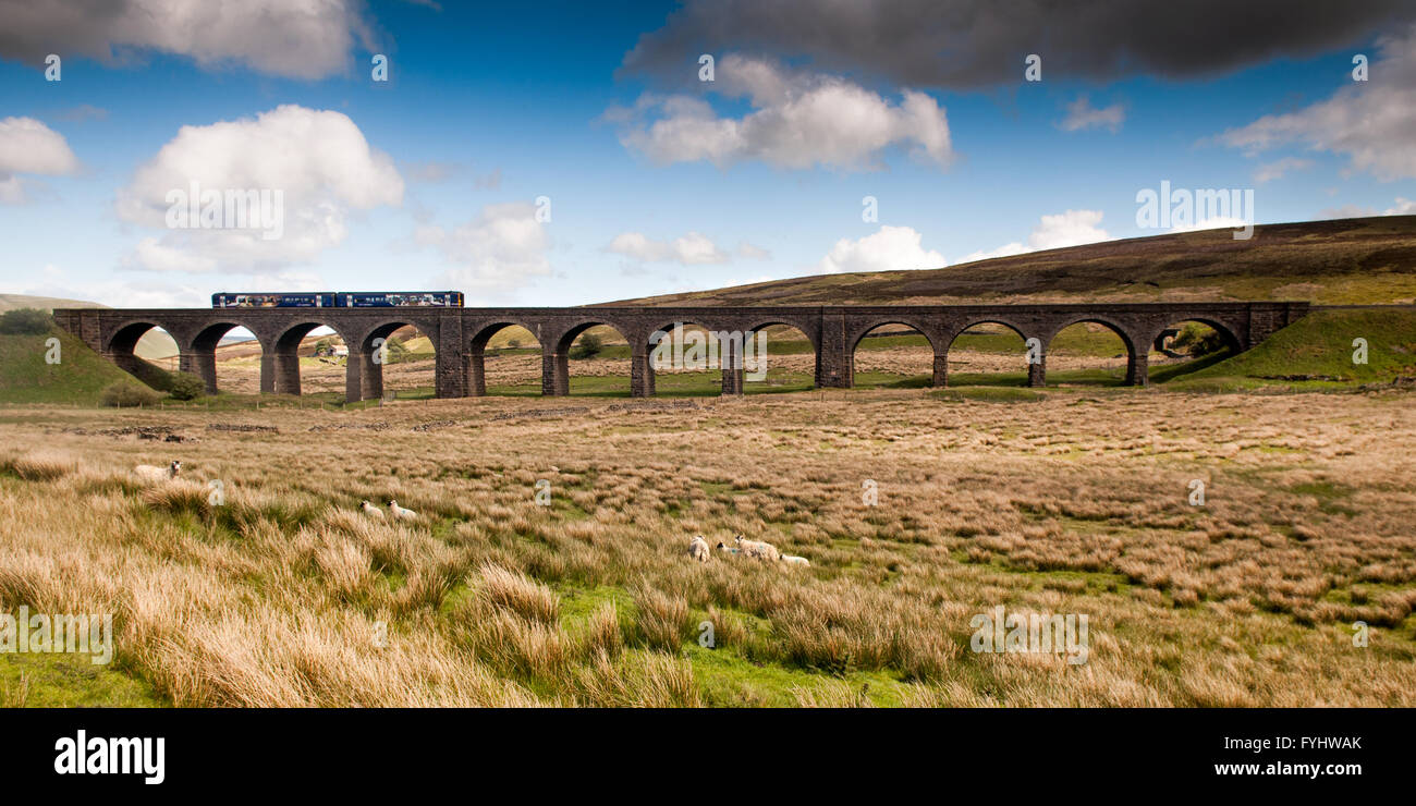 A Northern Rail Class 158 diesel passenger train crossing Dandry Mire Viaduct on the Settle-Carlisle Railway in - Stock Image
